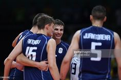 Italy's Simone Giannelli and teammates react after scoring during the men's Gold Medal volleyball match between Italy and Brazil at the Maracanazinho stadium in Rio de Janeiro on August 21, 2016, at the Rio 2016 Olympic Games. / AFP / Johannes EISELE