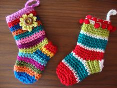 Free Christmas crochet patterns don't get much cuter than these Multicolored Miniature Christmas Stockings. These can be used for a variety of things this holiday season including tree ornaments, gift card holders, and more. Crochet Gratis, Crochet Amigurumi, All Free Crochet, Crochet Socks, Love Crochet, Rainbow Crochet, Diy Crochet, Crochet Style, Crochet Cardigan