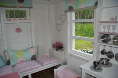 playhouse... Neat furniture ideas and looks like plexiglass windows. A different language though.