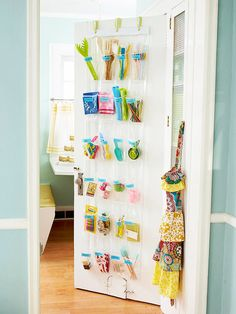 Organize Now- Kitchen Catchall: A shoe organizer that works just as well in the kitchen  How to make it: Add three screws to the top of the door and suspend a clear shoe bag from ribbon hangers. Label each pocket with a colored tag and store kitchen tools and supplies.