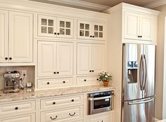 White or off white with light counter. Make sunny and open kitchen space.