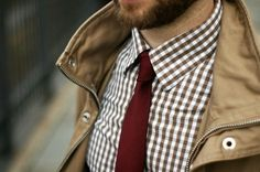 checkered shirt with solid colored tie.