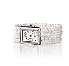 Sparkle in Paris Watch. Luxurious four strand pearl bracelet featuring a rectangular silver coloured timepiece with elegant dial. Stainless steel back, Quartz movement. Mercury-free battery.