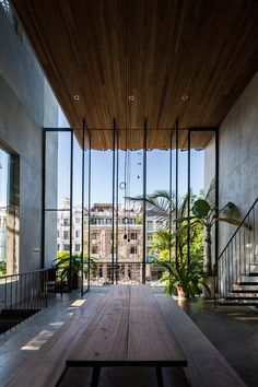 "The Thong House in Vietnam by Nishizawa Architects architecture studio - Journal du Design - With open interior spaces and huge windows that communicate with the outside, this house called ""Th - Interior Exterior, Exterior Design, Room Interior, Interior Windows, Kitchen Interior, Flying Spaces, Architecture Design, Amazing Architecture, Architecture Portfolio"