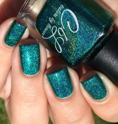 The Polish of the Month for August 2015 is called Believe in Miracles. A medium teal toned green that has an intense linear holo with lime and turquoise flash. 1-2 coat coverage. Swatch by @Jennpadd1