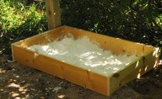 Think of it as a sandbox for chickens:  a dust bath using diatomaceous earth and wood ash
