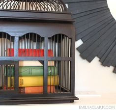 Accessorizing the mantel: books in a birdcage