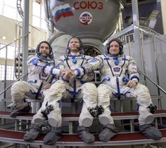 Russian cosmonaut Mikhail Kornienko of the Russian Federal Space Agency, Russian cosmonaut Gennady Padalka of Roscosmos and NASA Astronaut Scott Kelly pose outside a Soyuz simulator during the second day of qualification exams at the Gagarin Cosmonaut Training Center in Star City, Russia on March 5, 2015.