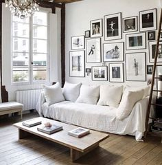 Chic living room with exposed beams, a large gallery wall, a white sofa, and a vintage chandelier Want to elevate the look of your small apartment? These modern apartment décor ideas will make your space feel bigger and more expensive. White Apartment, Parisian Apartment, Rustic Apartment, Apartment Ideas, French Apartment, Apartment Living, Paris Apartment Decor, Paris Decor, Apartment Layout