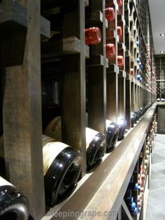 """wine wall - I could build this... Just build the vertical sections individually, with 1"""" x 1"""" strips of wood (for holding the wine bottle), and then assemble the entire thing."""