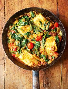 Salmon and Spinach Curry. This light, simple salmon, spinach and tomato curry from Meera Sodha's brilliant Made in India cookbook is a perfect midweek meal. Easy to prepare and bursting with flavour, it's an ideal quick curry dish for a busy midweek meal. Tomato Curry, Spinach Curry, Salmon Curry, Fish Curry, Cooking Recipes, Healthy Recipes, Weekly Recipes, Uk Recipes, Healthy Dinners