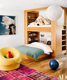 At the Los Angeles home of designer Brigette Romanek, the loft bed in a daughter's room was fabricated by Quality Custom Cabinetry. The chair is by Gaetano Pesce | archdigest.com