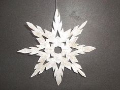 How to make paper snowflakes. These are beautiful- I wonder if I could stiffen them somehow so they dont blow away?