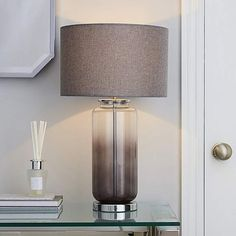 A bit like Darjeeling tea or G&T, our Shardy lamp's Indian glass base and British shade are the happy result. Modern Bedside Table, Grey Table Lamps, Table Lamps For Bedroom, Table Lamp Wood, Bedside Table Lamps, Glass Table, Grey Lamps, Modern Table, Desk Light