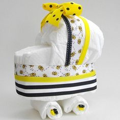 Diaper Carriage. Use ribbon that is in the theme colors of the baby shower and use as the center piece for mom's table.