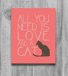 "Not for my office, but I want this! Happy Cat Print: If you love putting up happy prints in your office, then this ""All You Need Is Love and a Cat"" print ($10-$25) is perfect."