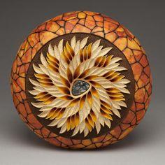 """Vortex #2"" - 11.5 in in diameter. Carving by Mark Doolittle; paper applique by Kathy Doolittle. Bernard Wolf, photography."