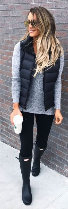 #fall #outfits  women's heather gray sweater and black zip-up bubble vest