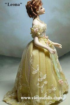 A 1:12 miniature porcelain doll