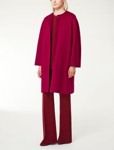 MAXMARA | Coat in double layered sable look pure cashmere featuring kimono sleeves and side pockets. The hand made detail, which combines two layers of fabric, means that the garment has no need of a lining. Concealed press-stud fastenings | Product name: GIUDEA | Product code: 1086055506005 | Colour: Fuxia | €2,300