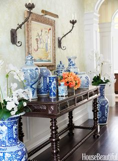 In the entrance hall, an arrangement of porcelain on a British Colonial–style table