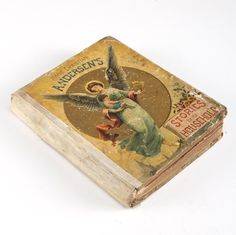 An 1893 copy of Stories for the Household book. This antique book is written by Dutch author Hans Christian Anderson and was published by McLaughlin Brothers in New York. The book itself contains several short stories and printed pictures. The hardcover exterior has a depictions of an angel along the cover.
