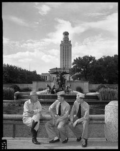 J. Frank Dobie- J. Frank Dobie seated with two men in uniform in front of The Littlefield Fountain and the UT tower. Jun11 1943