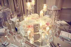 Pillar candle holders, the acrylic or glass table numbers, hydrangeas, roses, brunia, on random tables - Centerpiece #1