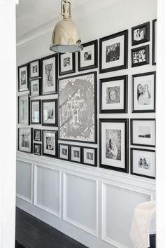 Black and white gallery wall down a long hallway.  Pawleys Island Posh: