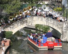 Music drenches the riverwalk.