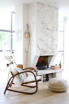 Gorgeous white brick fireplace with cozy surrounding decor