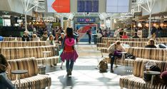 Keflavik International Airport | Green Furniture Concept. Slightly curved and modular wooden benches in seamless seating rows. Oak wood with mix of colours by tinted hardwax oil.