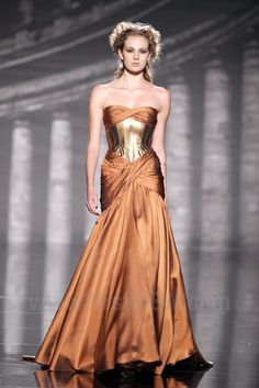 Rami Al Ali Fall / Winter 2011. Wow, this woman has no hips, and really wide shoulders. Apparently that's the runway standard, along with being tall. One wonders why they don't just model thin men in dresses.