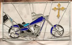 Custom panel of an American Chopper.  I made the glass for the flag and the rim detail is a copper overlay.