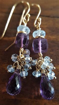 These sparkling earrings feature beautiful genuine gemstones! I chose these particular gems because I loved the color combination of purple and light blue. At the center of the pair are pretty cube shaped Amethyst stones which I accented by using a gold vermeil Karen Hill Tribe