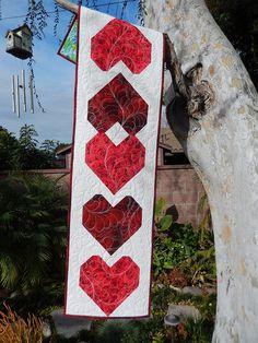 Valentine Hearts runner, deep reds, feather quilting