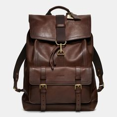 Equal parts rugged and refined, this handsome backpack combines glove-tanned leather and traditional craftsmanship with efficient modern design. Lined in fabric and featuring signature hardware and a drawstring closure, it accommodates the needs of the tech-savvy with multiple pockets for portable devices, as well as ample room for a laptop.