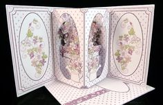 - A lovely pop out card with 3 pop out elements giving a nice depth. Decorated all round with a blank greetings panel on the . Craft Projects, Projects To Try, Pop Out, Lilacs, Flower Boxes, Card Designs, Scissors, Paper Flowers, Tea Lights