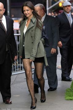 Katie Holmes displayed her sensational legs in sheer tights and shorts for a Good Morning America appearance on Wednesday