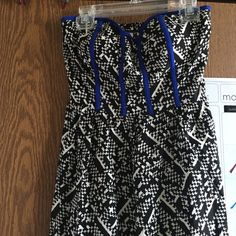High-low, long, summer dress Black and white patterned dress with blue detailing. Ankle length at lowest point. Worn maybe twice. Dresses Maxi