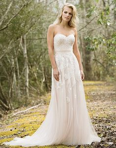 A sweetheart neckline, self-tie belt at the natural waist, beaded sequined lace appliqués, Jersey lining, and chapel length train create this whimsical slim A-line gown.