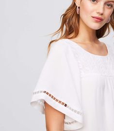 This embroidered top is romantic