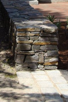 Use native stone to build walls. Dry Stone, Brick And Stone, Stone Work, Stone Walls, Masonry Work, Stone Masonry, Landscape Walls, Landscape Design, Rock Retaining Wall