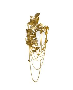 Made in brass with gold plated, handmade butterflies and majestic flowers, ending with the touch of beautiful Swarovski crystals. The wall version of McQueen chandelier, evokes a dramatic and eccentric sensation of beauty.