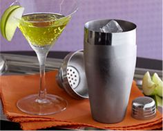 Our fave Appletini: Vodka, apple schnapps and a hint of orange liqueur, all shaken with tons of ice, then strained into a martini glass. #recipe #cocktail