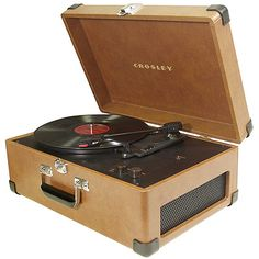 record player...we didn't have such a beautiful one, but it's the idea