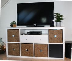 KALLAX shelving unit with doors, black-brown, on its side as a TV stand