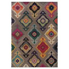 Stylishly anchor your living room or master suite with this alluring woven rug, showcasing a multicolor ikat-inspired medallion motif.   Product: RugConstruction Material: PolypropyleneColor: Grey and multiFeatures:  Made in EgyptMachine-wovenPile Height: 0.43