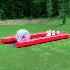 """The Human Bowling Ball. Description This is the inflatable bowling game that challenges players to assume the """"roll"""" of the ball in knocking down a set of pins. The transparent PVC ball is inflated to its full 7' diameter with the included blower a zipper cinches the ball closed yet opens quickly to allow egress and quick entry for another player. A player simply runs forward inside the ball, generating momentum to knock over six 5'-tall foam pins that yield easily at the point of collision…"""