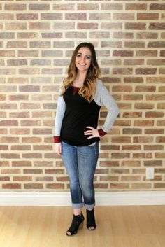 If this isn't the cutest outfit I've ever seen! Bailee raglan top (black body, grey sleeve and burgundy cuffs) paired with some jeans and the black peep toe Taylor booties. Shop this look at Jourdan's Jewels!